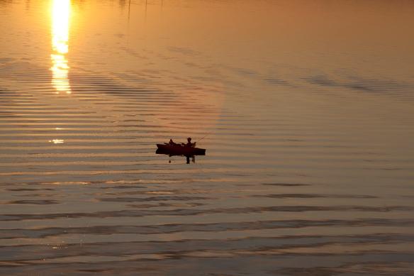 fisherman in water
